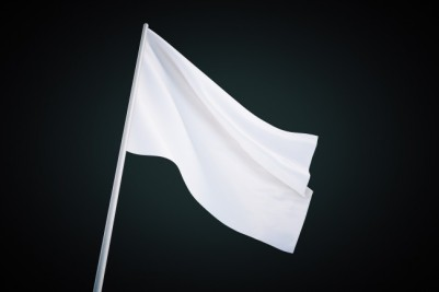 bigstock-waving-white-flag-118845239-650x433